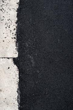 New asphalt concrete near the concrete kerb