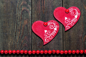 Two wooden hearts with ornament