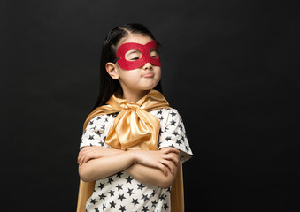 Superhero kids on a black background