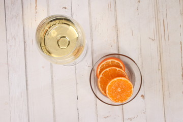 champagne wine glass and slice orange