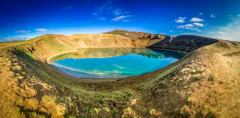 Panorama of blue lake in the crater of a volcano in Iceland