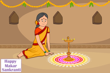 Woman making rangoli for Makar Sankranti