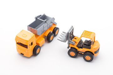 Two orange toy construction