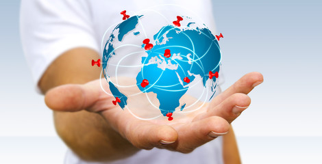 Businessman holding digital world map in his hands
