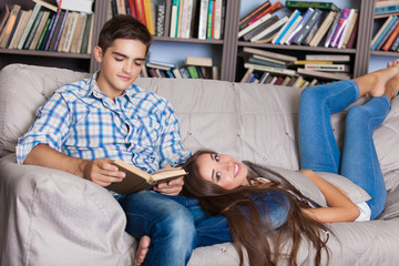 love, family and happiness concept - man with young woman at home