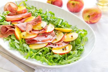 Fresh salad with bresaola, arugula and nectarines