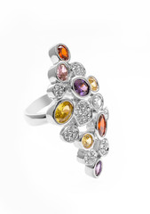 Silver ring with colored stones on a white background