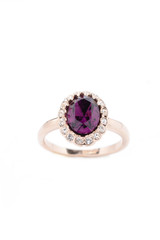 ring with purple stone on white background
