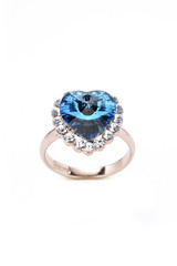 ring with a blue heart on a white background