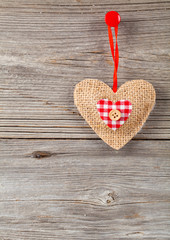 Heart shaped decoration made, over wooden background