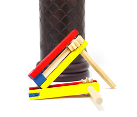 Colorful wooden noisemaker with Megillah Purim holiday background