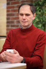 Mature man with smartphone