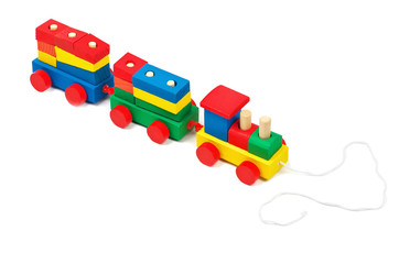 Wooden colorful toy train with rope isolated on white background