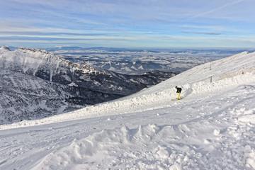 Downhill Skier on top of Kasprowy Wierch in Zakopane in Tatras in winter
