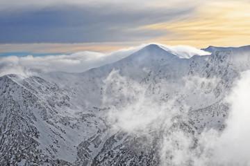 Sun and clouds atop of Kasprowy Wierch in Zakopane on Tatras in winter