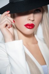 Beautiful blonde lady with pretty headwear