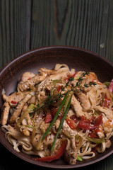Egg noodles with chicken (TERIYAKI) into a bowl, Thai