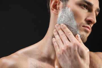 Handsome guy is ready to shave his beard