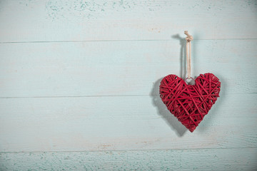 Valentine red heart  on old wooden  table