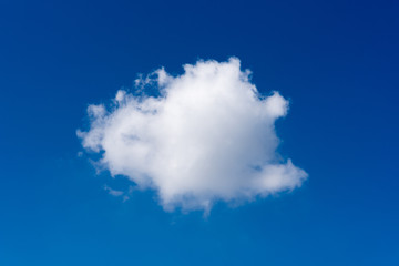 Single white cloud on blue sky background at daytime