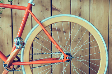 fixed gear bicycle parked with wood wall, close up image