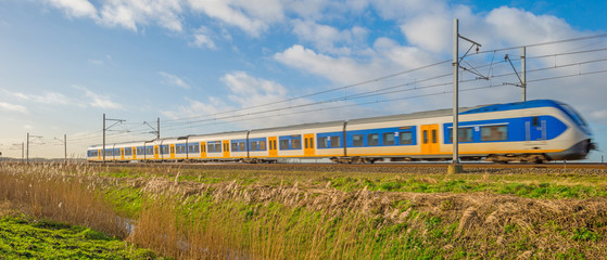 Electric train driving through nature in winter