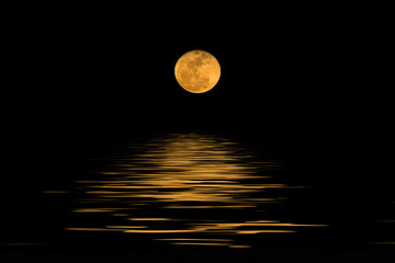 Full moon over cold night water
