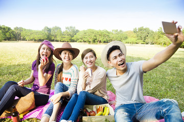 happy young group making selfie by  smart phone
