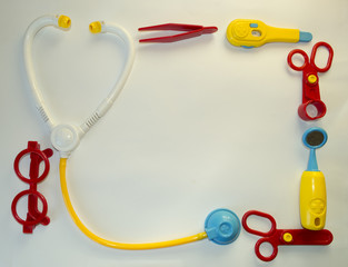 Background with toys medical tools and place for text
