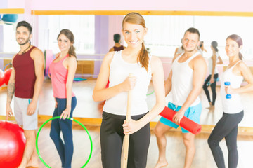 Young group people lead healthy lifestyle, exercise in fitness r