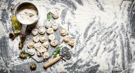 Fresh ravioli with flour and quail egg.