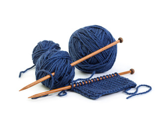 Balls of wool blue colors and knitting on wooden needles
