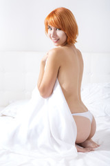 redheaded woman in the bedroom