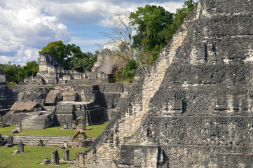 North Acropolis structures and Temple I on the Grand Plaza, seen from the Central Acropolis of Tikal National Park and archaeological site, Guatemala