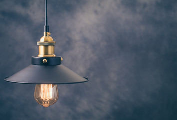 Retro light lamp at left of gray background