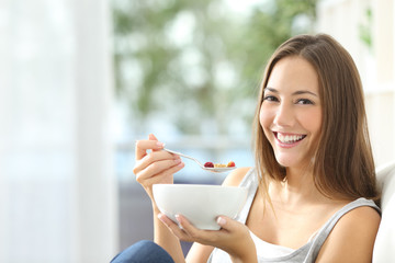 Woman eating cornflakes at home