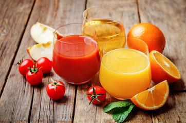set of juices: orange, tomato and apple