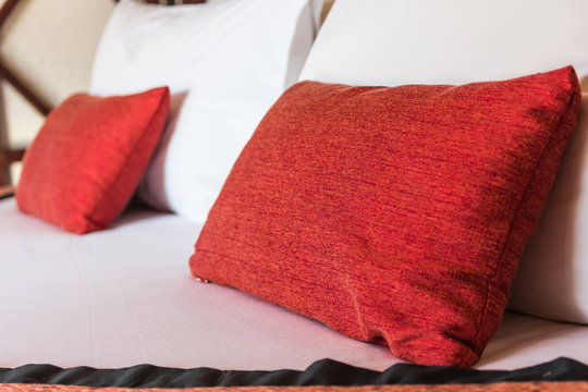Double bed with pillows in red color.sensitive focus