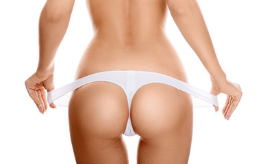 Perfect female sexy buttocks in white lingerie.