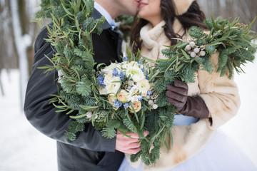Beautiful wedding bouquet with spruce scarf
