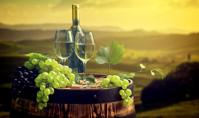 Wall Mural -  wine bottle and wine glass on wodden barrel. Beautiful Tuscany