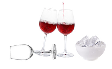 Red wine with ice cube in the cup on white background
