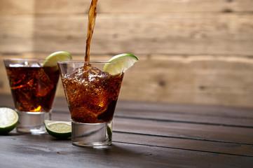 Pour the rum and cola cuba libre