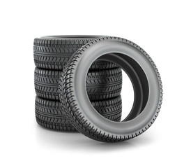 Stack of four wheel new black tyres for  car isolated on white b