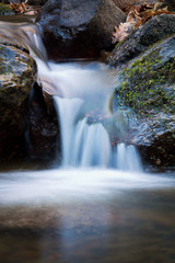 great wonders of nature -  soft misty river waterfall in forest in automn winter season - long exposure