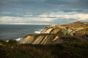breaking waves of atlantic coast in winter season in rays of sun