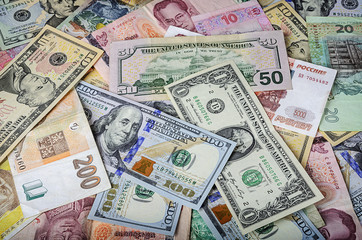 A collection of various foreign currencies from countries spanning the globe.