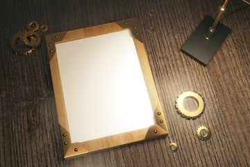 Top view of steampunk background with blank picture frame on a w
