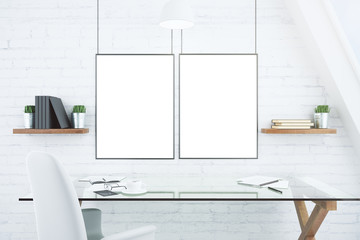 Blank white picture frames on brick wall in modern office with g