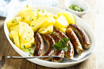 Fried sausages with potato salad